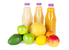 Fresh bottles of juice with fruits isolated on white Royalty Free Stock Image