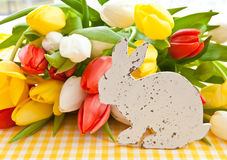 Fresh bouquet of tulips and a easter bunny Stock Images