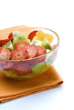 Fresh bowl. Fresh fruit salad bowl in a white background Royalty Free Stock Photography