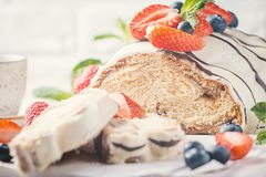 Fresh braided bread. Fresh sweet braided bread in white chocolate with fresh berries Stock Photo