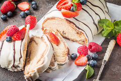 Fresh braided bread. Fresh sweet braided bread in white chocolate with fresh berries Royalty Free Stock Photography