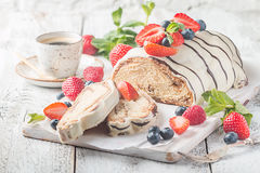 Fresh braided bread. Fresh sweet braided bread in white chocolate with fresh berries Royalty Free Stock Photos
