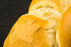 Loaf of white wheat bread. Fresh braided loaf of white wheat bread on black background stock image
