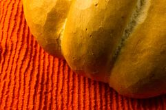 Loaf of white wheat bread. Fresh braided loaf of white wheat bread on an orange napkin stock images