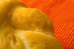 Loaf of white wheat bread. Fresh braided loaf of white wheat bread on an orange napkin stock photos