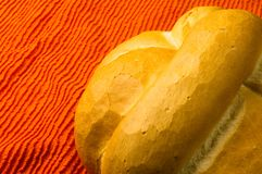 Loaf of white wheat bread. Fresh braided loaf of white wheat bread on an orange napkin royalty free stock image