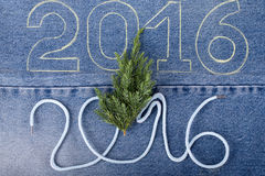 Fresh branch of christmas tree and the numbers 2016 of rope and Royalty Free Stock Photo