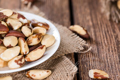 Fresh Brazil Nuts. Some Brazil Nuts on vintage wooden background stock photos