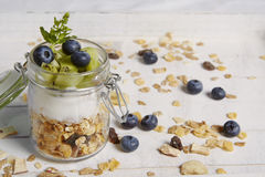 Fresh breackfast with cereals yogurt blueberry and kiwi Royalty Free Stock Photo