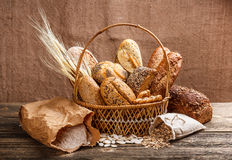 Fresh bread. In the basket on wooden background stock images