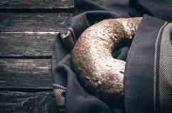 Barley porridge. Fresh bread on aged wooden table background. Bakery Stock Image