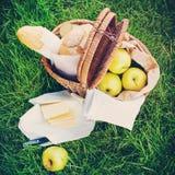 Fresh Bread, Apples in a Wattled Basket Stock Image