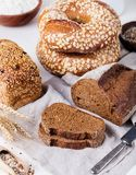 Fresh bread assortment on a textile background. Rustic background. Stock Photo