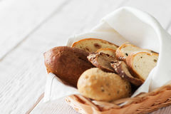 Fresh bread assortment, white wooden background Royalty Free Stock Images