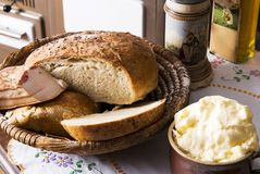 Fresh bread, bacon and homemade butter Royalty Free Stock Photos
