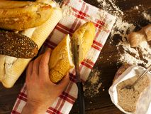 Fresh Bread and Baguettes on work surface stock image
