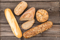 Fresh bread and bakery on an old vintage planked w Royalty Free Stock Images