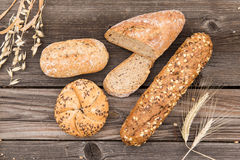 Fresh bread and bakery on an old vintage planked w Royalty Free Stock Photo