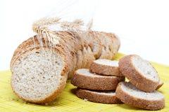 Fresh bread on a bamboo napkin Stock Photos