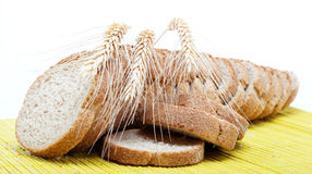 Fresh bread on a bamboo napkin Stock Images
