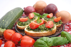 Fresh bread with basil pesto Royalty Free Stock Photos