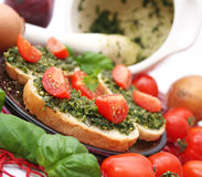 Fresh bread with basil pesto Royalty Free Stock Photography