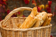 Fresh bread in the basket. On a background autumn leaves Stock Photo