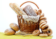 Fresh bread in the basket fully . Fresh bread in the basket fully  on a white background Royalty Free Stock Images