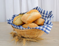 Fresh bread in a basket with a napkin shelter Royalty Free Stock Photos