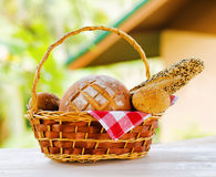Fresh bread in the basket on natural background Royalty Free Stock Photo