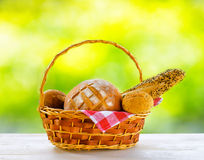Fresh bread in the basket on natural background Stock Photos