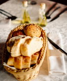 Fresh bread in basket. Slices roll breads in basket on table Stock Photography