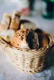 Fresh bread in basket. Slices roll breads in basket on table Royalty Free Stock Photos
