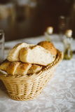 Fresh bread in basket. Slices roll breads in basket on table Stock Photos