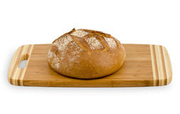 Fresh bread on the board. Fresh bread on the board isolated on the white background Stock Photography
