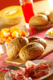 Fresh bread for breakfast. With fruit in the background Stock Photo
