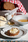 Fresh bread with butter anh honey Stock Images