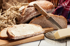 Fresh bread with butter Royalty Free Stock Photography