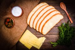 Fresh bread, cheese and fennel on a wooden table Stock Photo
