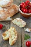 Fresh bread ciabatta. And cherry tomatoes Royalty Free Stock Photos