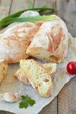 Fresh bread ciabatta. And cherry tomatoes Stock Image