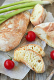Fresh bread ciabatta. And cherry tomatoes Royalty Free Stock Image