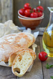 Fresh bread ciabatta. And olive oil, cherry tomatoes Royalty Free Stock Photo
