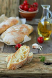 Fresh bread ciabatta. And olive oil, cherry tomatoes Stock Photography
