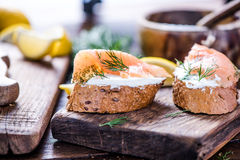 Fresh bread cottage cheese and smoked salmon with dill Royalty Free Stock Photo
