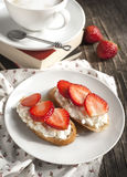 Fresh bread with Cottage cheese, strawberry and honey. Royalty Free Stock Photos