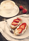 Fresh bread with Cottage cheese, strawberry and honey. Toned ima Stock Image
