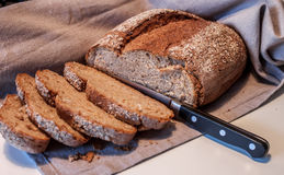 Fresh bread cut by knife Royalty Free Stock Photography