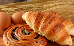Fresh bread danish and croissant wheat on the wooden. stock photography