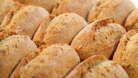 Fresh bread, dark buns, food background stock video